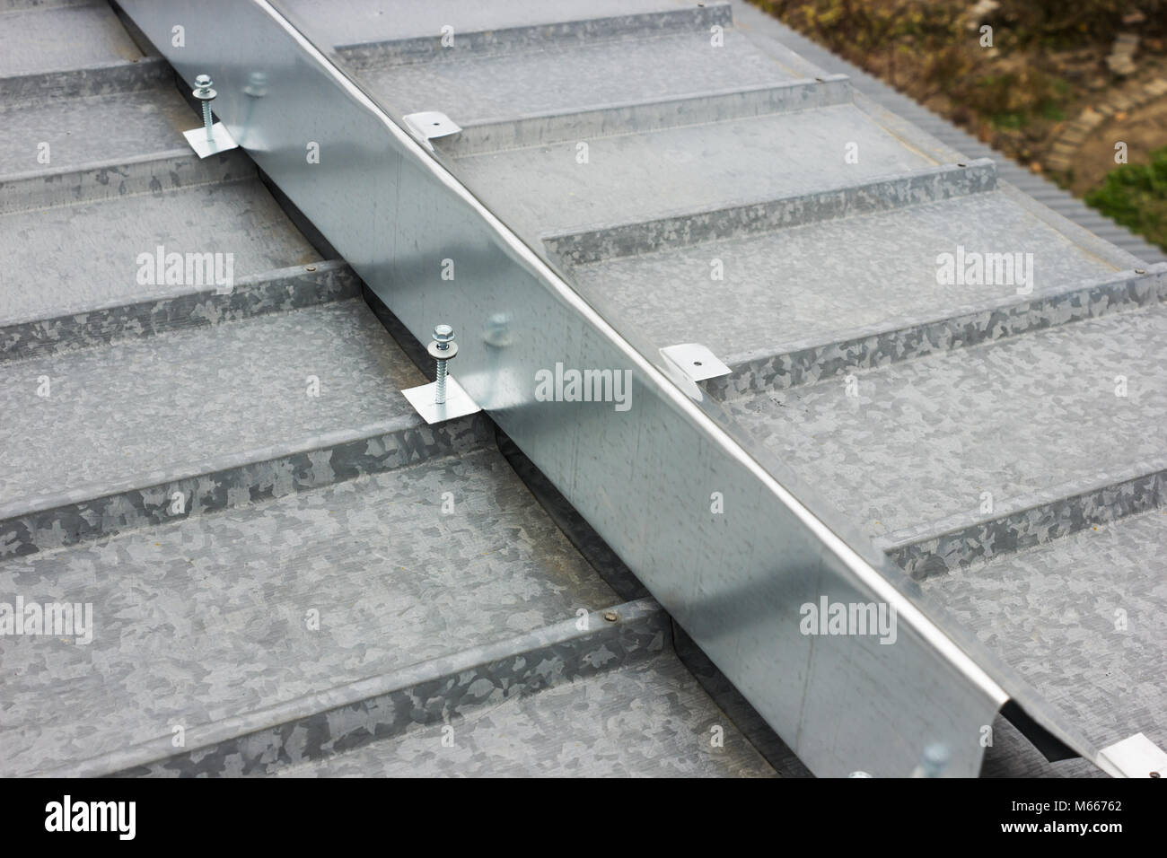 The barrier for snow retention on the metal roof - Stock Image