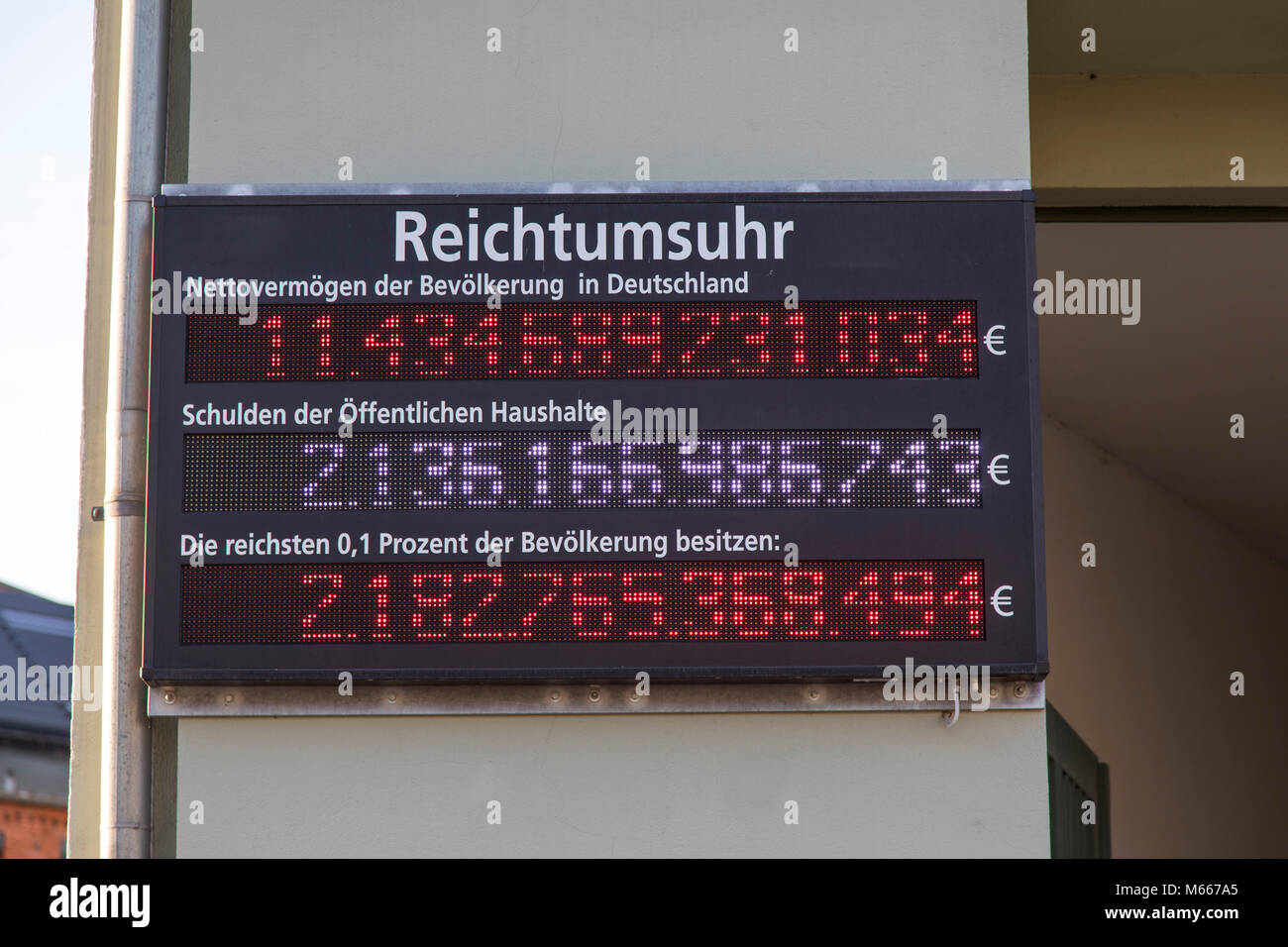 Berlin, wealth clock, net wealth, debt, public budgets, wealth, poverty, euro, counting, numbers, digits, ad, - Stock Image