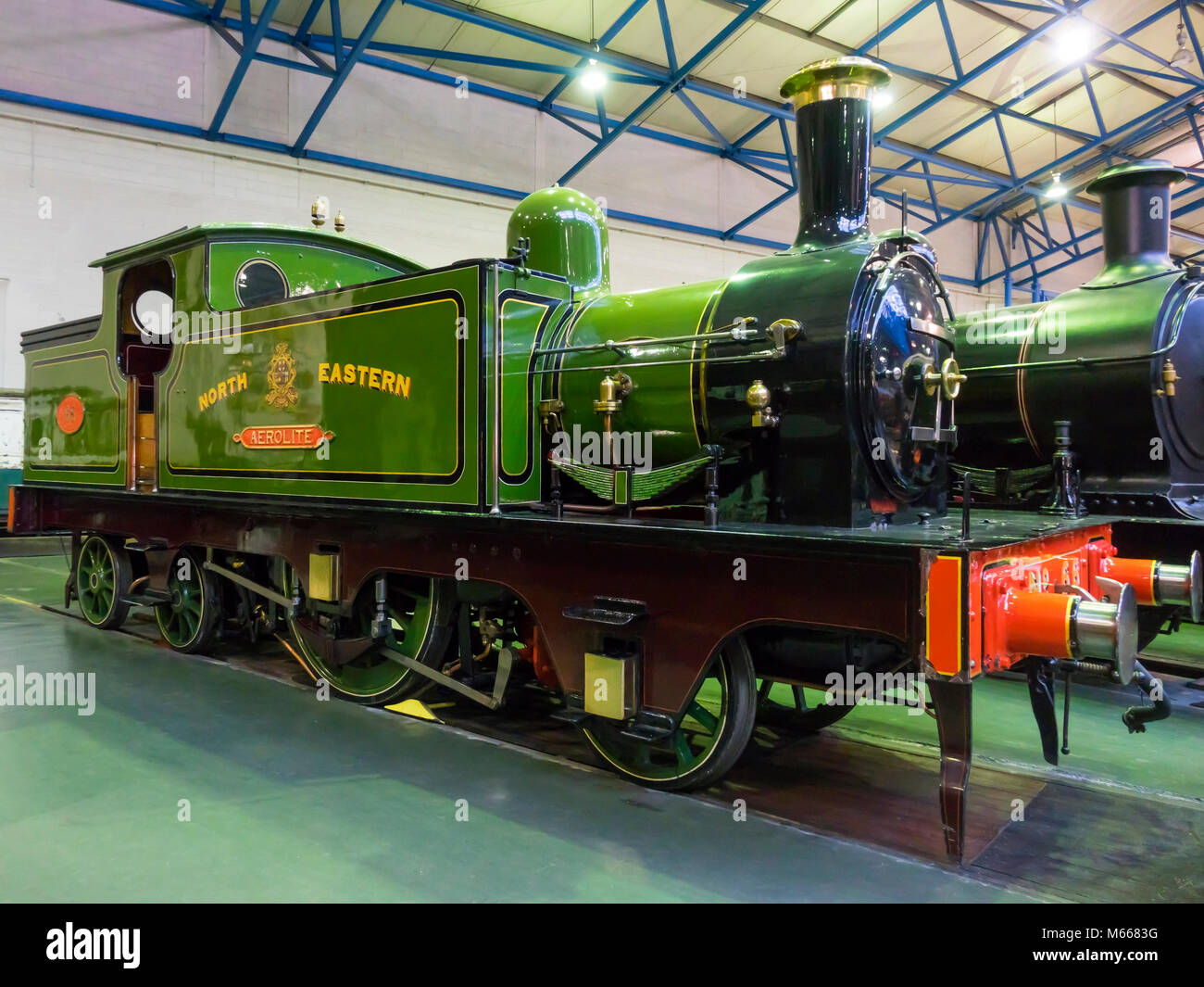 Great Hall at the National Railway Museum York with North Eastern Railway Tank steam locomotive engine Number 66 - Stock Image