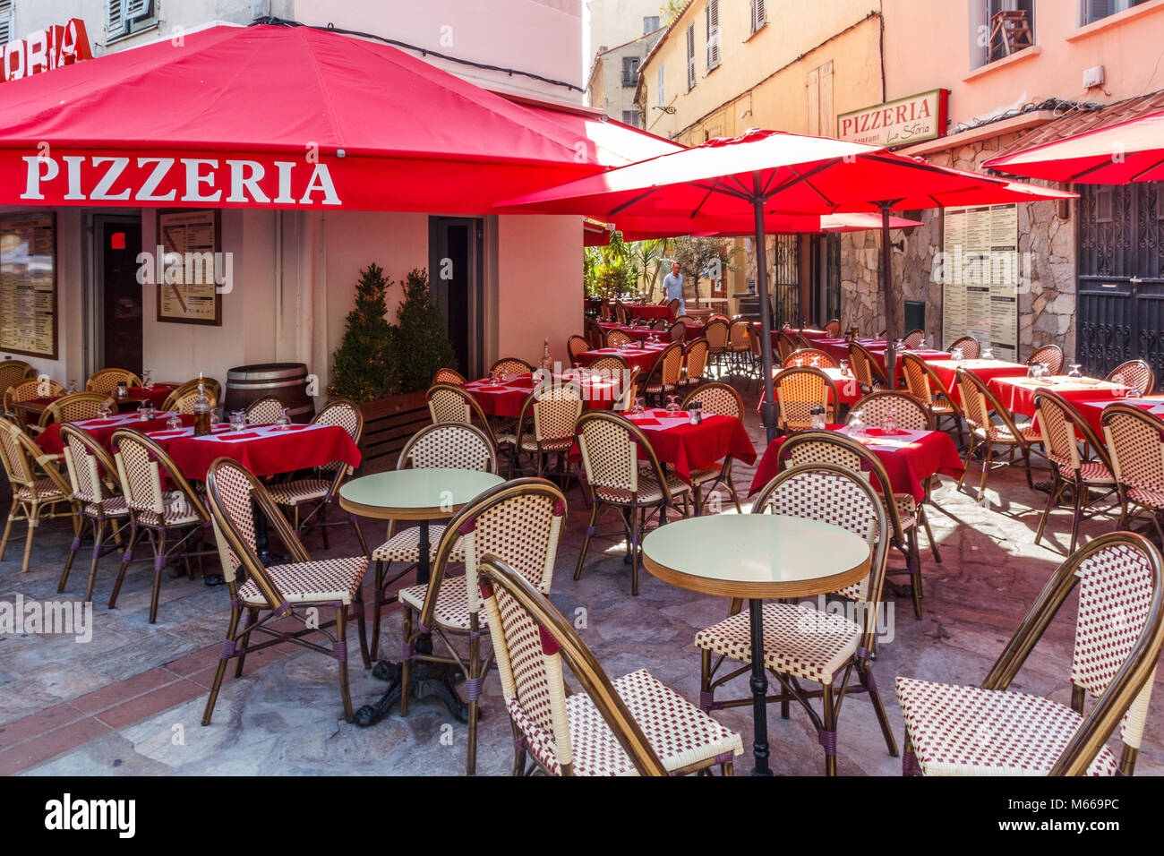 Tables and chairs outside a pizzeria, Ajaccio, COrsica, France - Stock Image