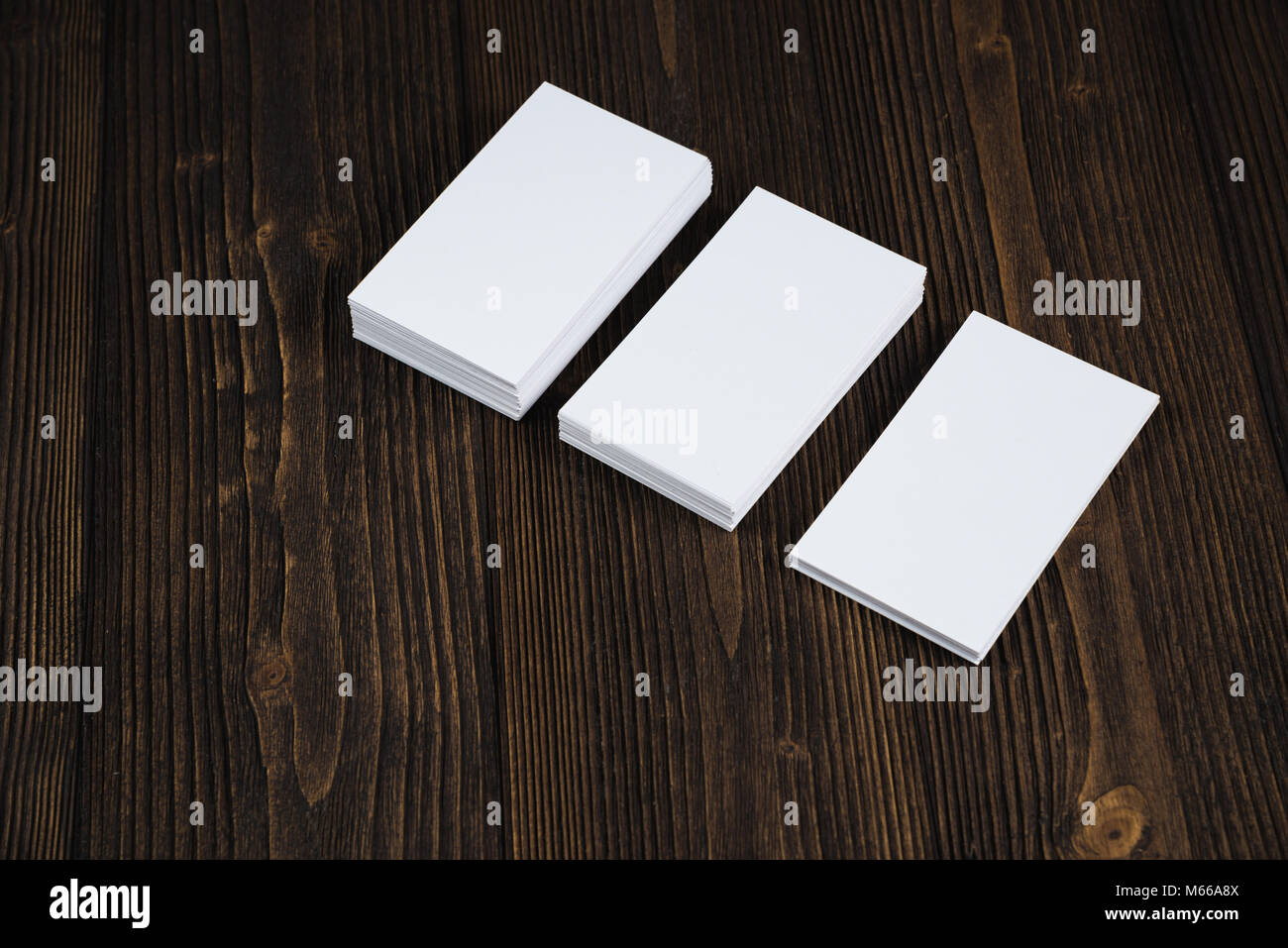 Blank business cards on wooden working table with copy space for add ...