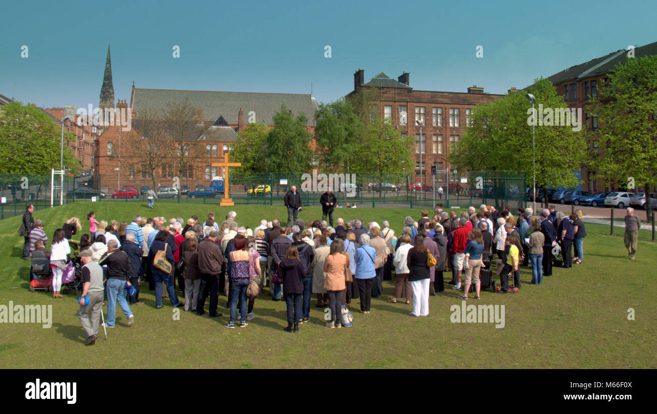 open air good Friday service with cross Easter Partick, Glasgow, UK - Stock Image