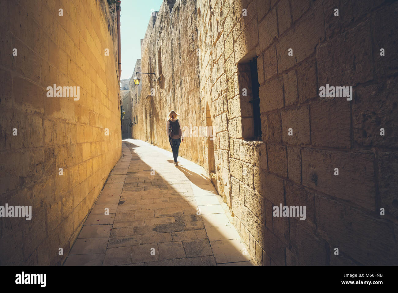 Narrow streets of the old Mdina. Tourist walking. Typical architecture in Malta - Stock Image