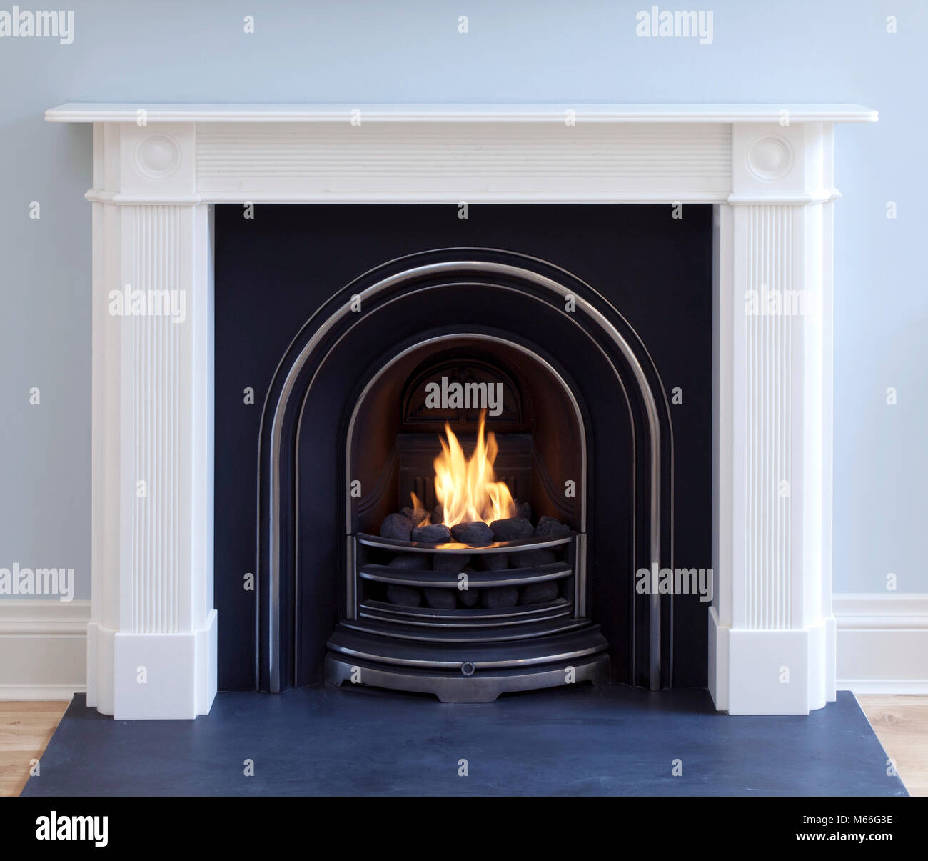 open coal effect gas fire with metal fire place with flames - Stock Image