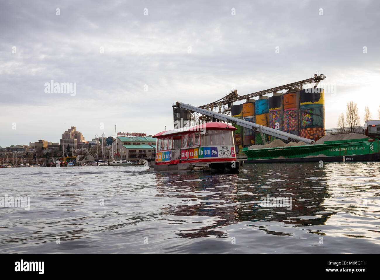 Downtown Vancouver, British Columbia, Canada - January 28, 2017 - A small taxi ferry boat is riding in False Creek Stock Photo