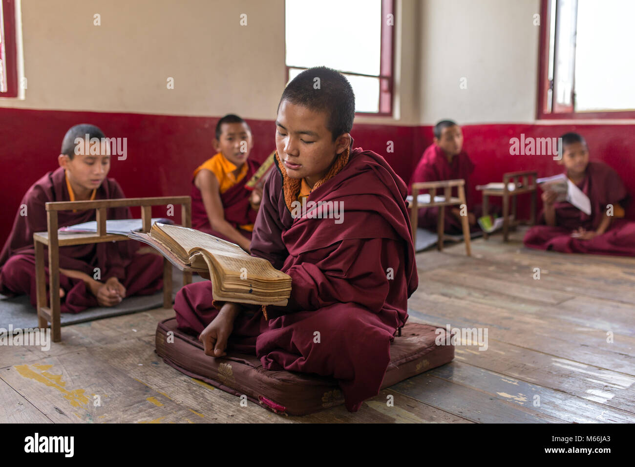 Gangtok, India - May 3, 2017: Lesson for novice monks in buddhist Tsuglakhang monastery in Gangtok, India - Stock Image