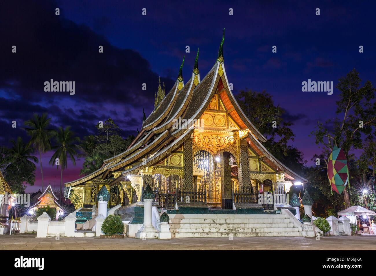 Wat Xieng Thong temple at night in Luang Prabang, Laos Stock Photo