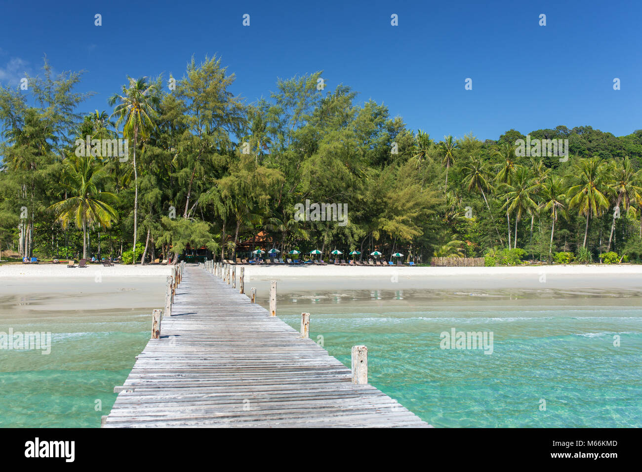 Wooden pier to a tropical island beach on Koh Kood island during day time, Thailand. - Stock Image