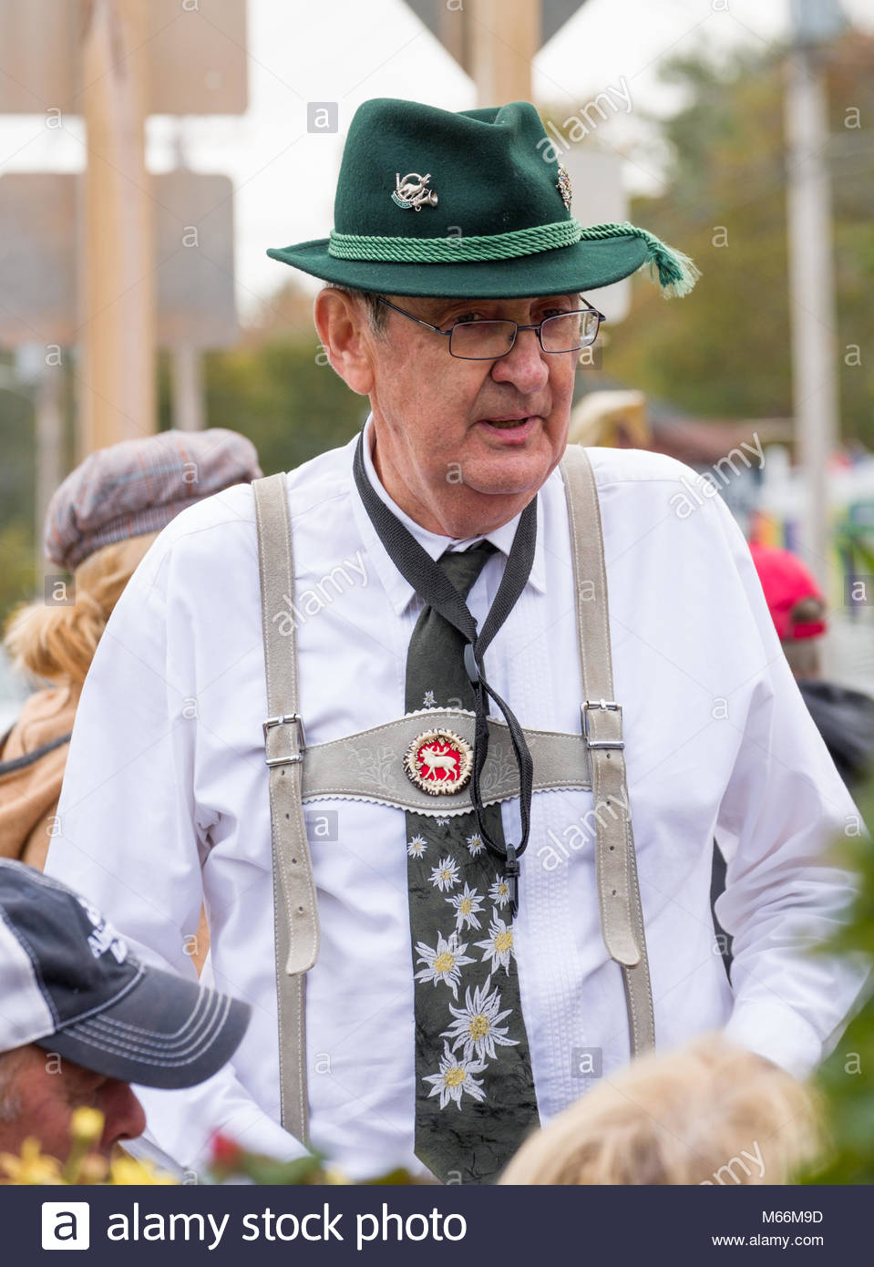 Man wearing lederhosen and Bavarian hat, Main Street, Ogunquit, York County, Maine, USA - Stock Image