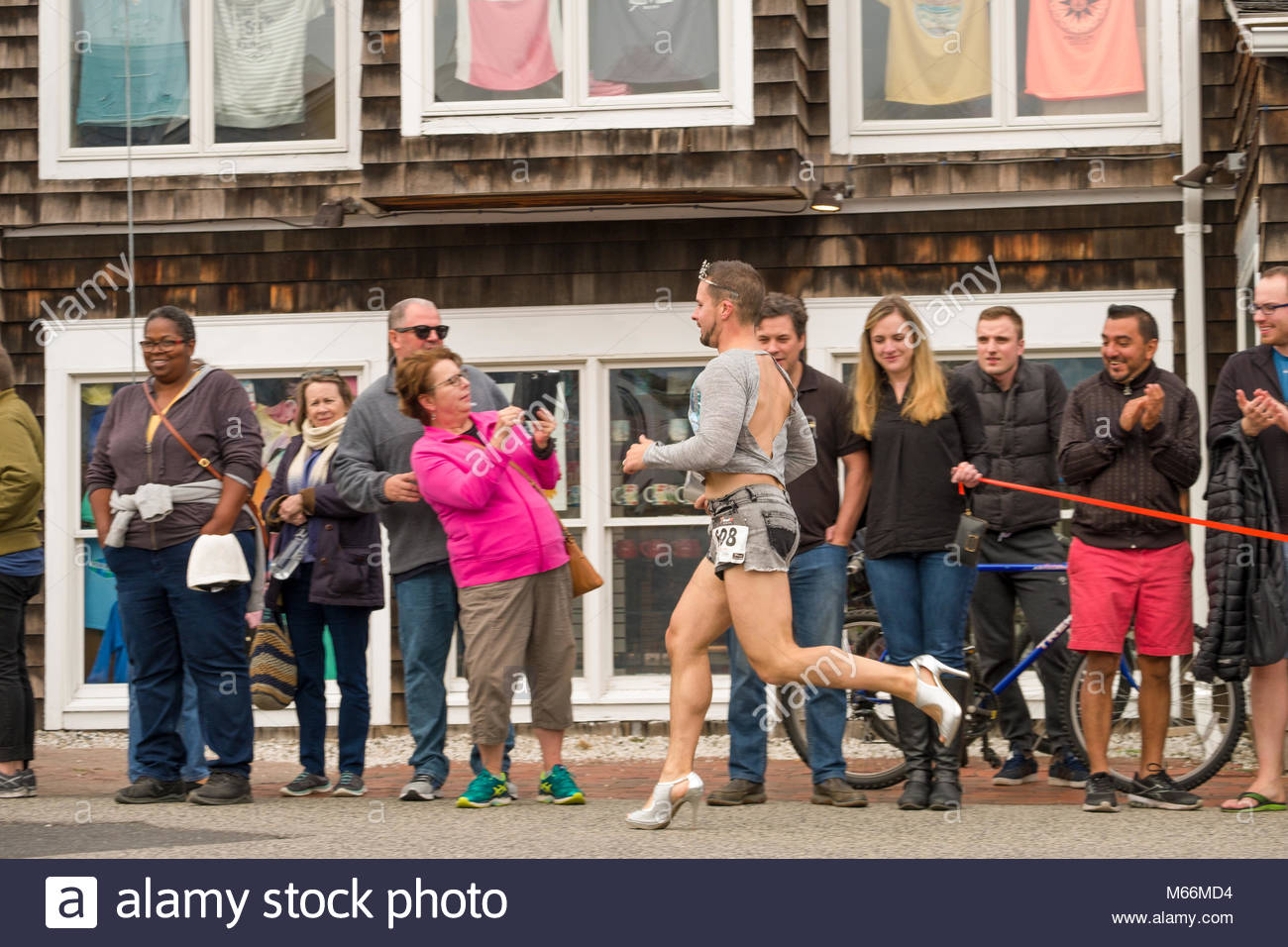 Man running in high heels during the OgunquitFest High Heel Dash, Perkins Cove, Ogunquit, York County, Maine, USA - Stock Image