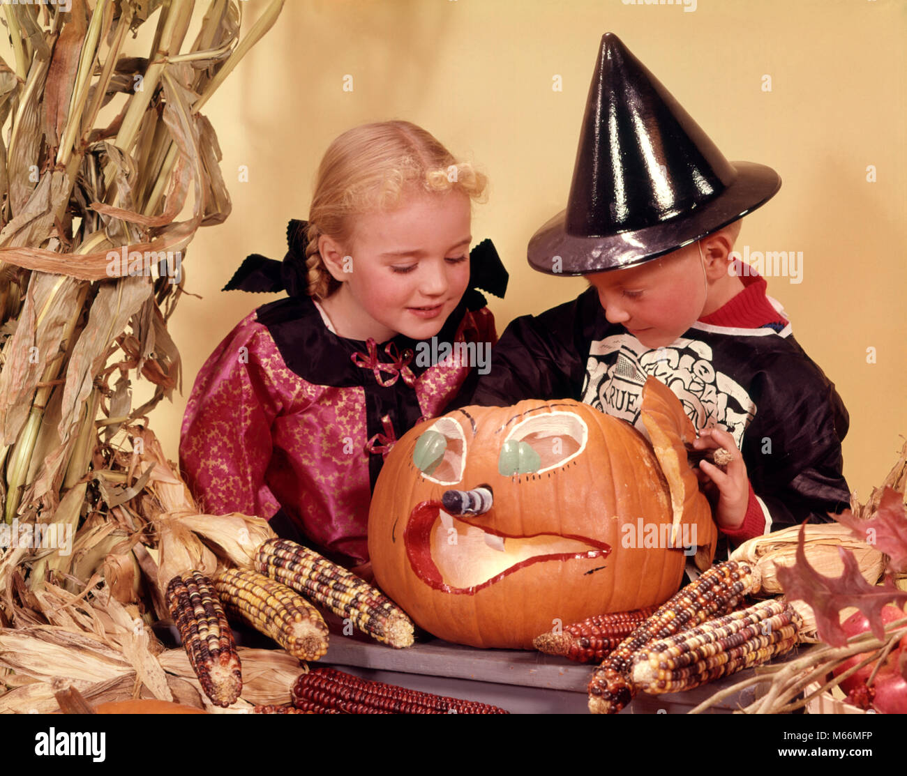 1960s TWO KIDS BLOND BROTHER AND SISTER WEARING HALLOWEEN COSTUMES LOOKING INTO CARVED JACK-O-LANTERN PUMPKIN - kh1601 HAR001 HARS LANTERN MYSTERY CAUCASIAN ...  sc 1 st  Alamy & 1960s TWO KIDS BLOND BROTHER AND SISTER WEARING HALLOWEEN COSTUMES ...