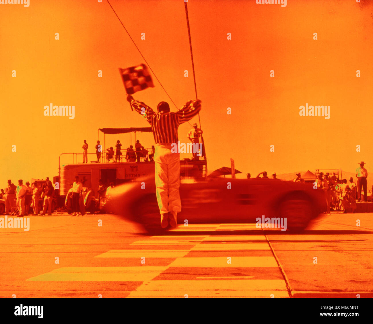 Race Cars Finish Line Stock Photos Pinewood Derby Lamps 1970s Man Waving Checkered Flag At End Of Sports Car Orange Filter
