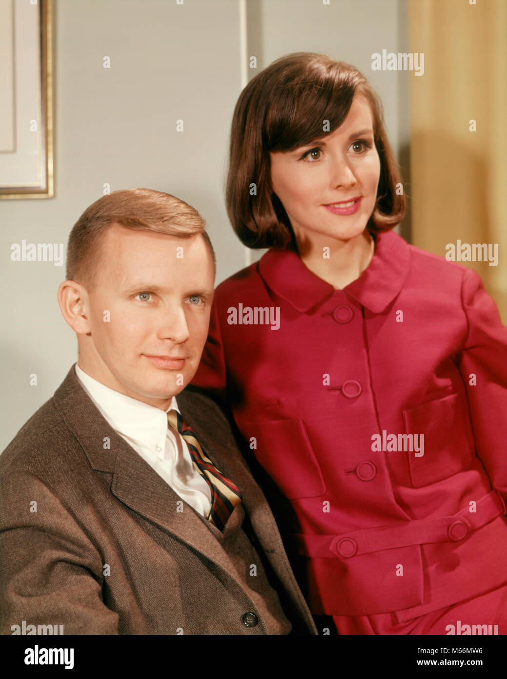 1960s Portrait Serious Young Couple Man In Business Suit Woman Stock