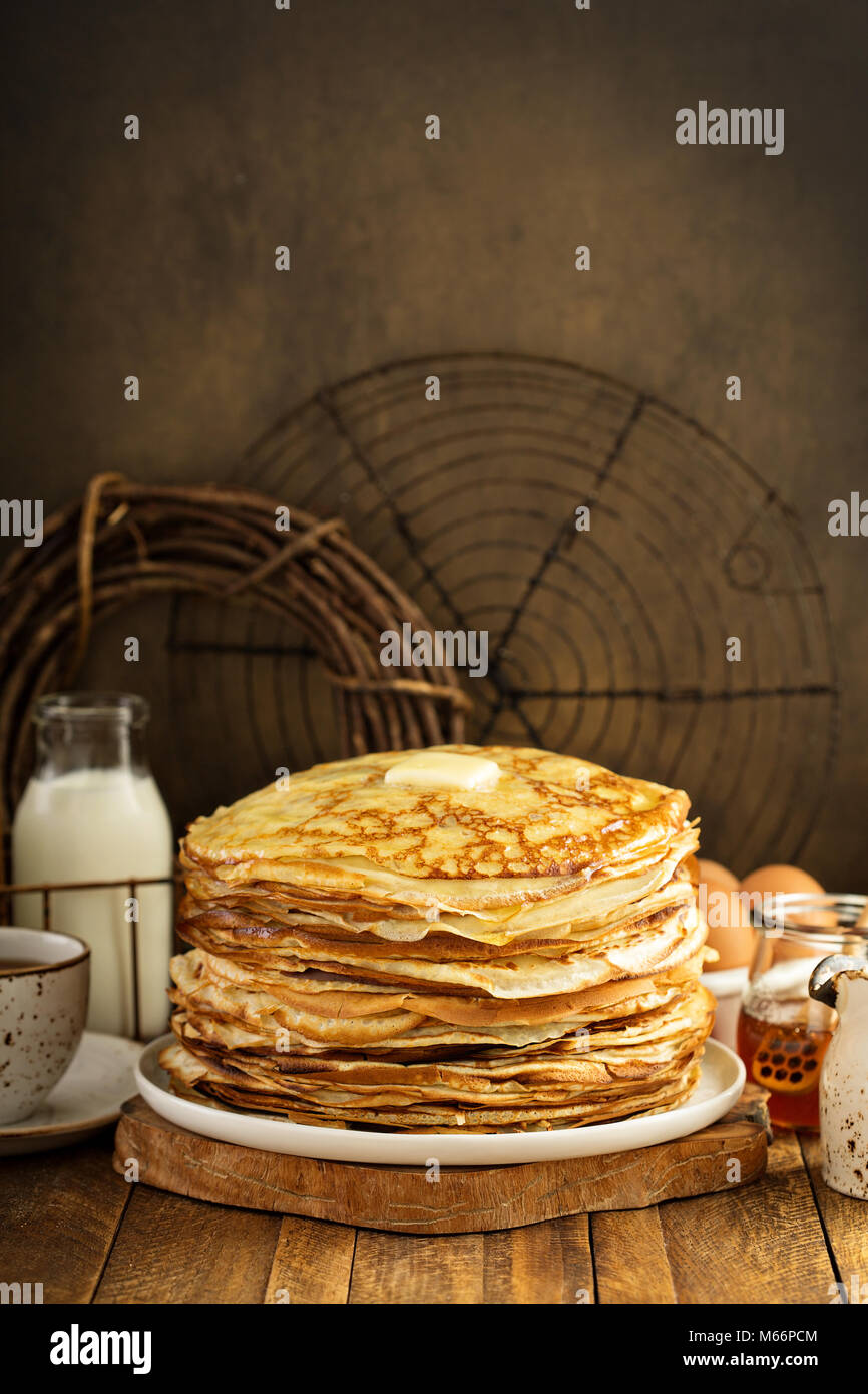 Big stack of homemade crepes or thin crepes - Stock Image