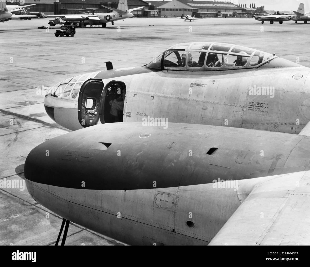 1950s FRONT OF JET AIRPLANE SLIDING COCKPIT FORWARD GUN BAY WITH DOOR OPEN ON TARMAC AT LANGLEY AIR FORCE BASE HAMPTON - Stock Image