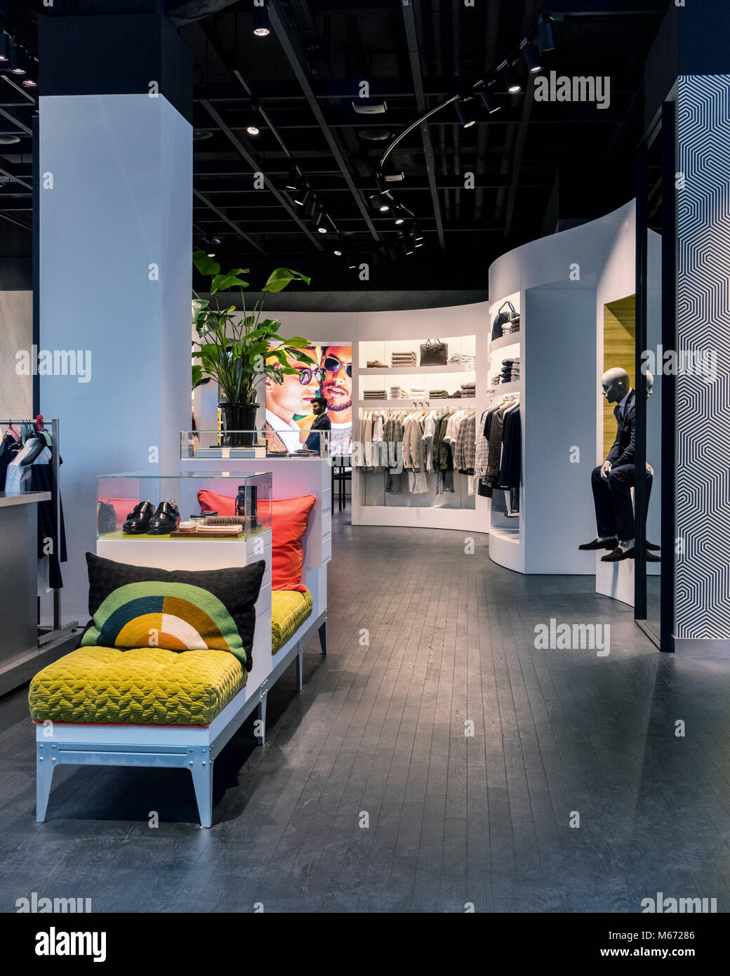 Berlin, Mitte. Suit Supply men's clothing store interior. Clothes shop for men - Stock Image