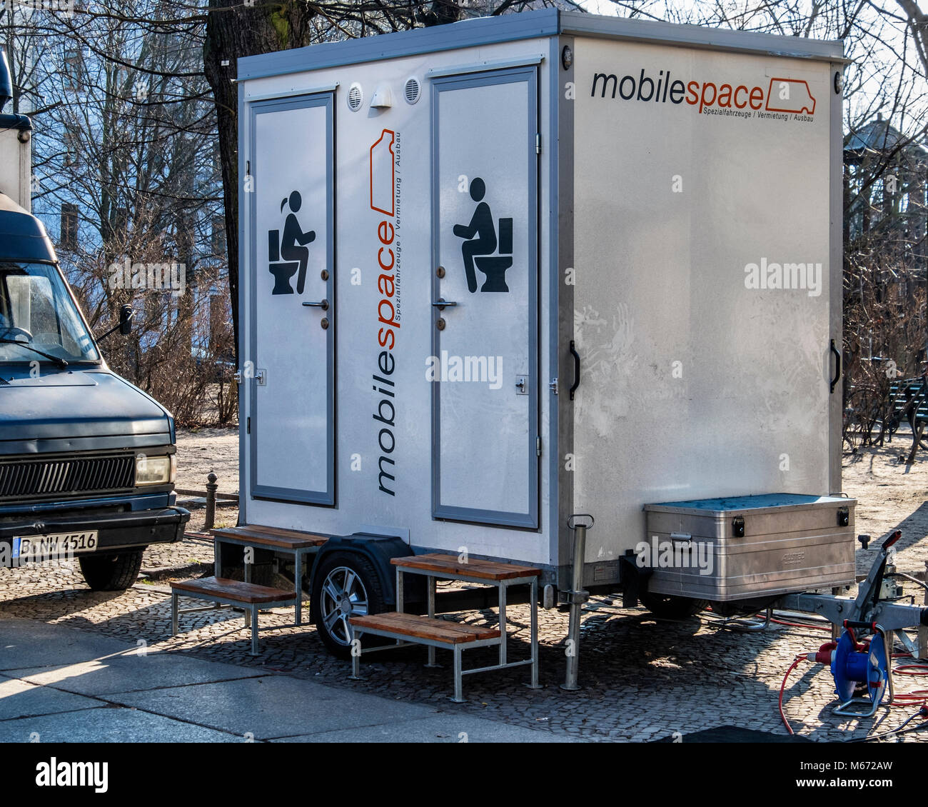 Mobile Male and female toilet on wheels with steps. Lavatory,loo,WC, - Stock Image