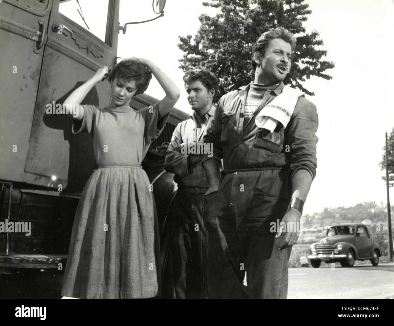 Italian actors Domenico Modugno, Carla Gravina and Geoffrey Horne in the movie Esterina, 1959 - Stock Image
