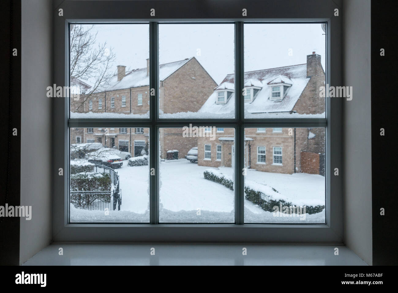 UK weather: Burley-in-Wharfedale, West Yorkshire, UK. 1st March 2018.  Snow children only dream of, clinging to - Stock Image