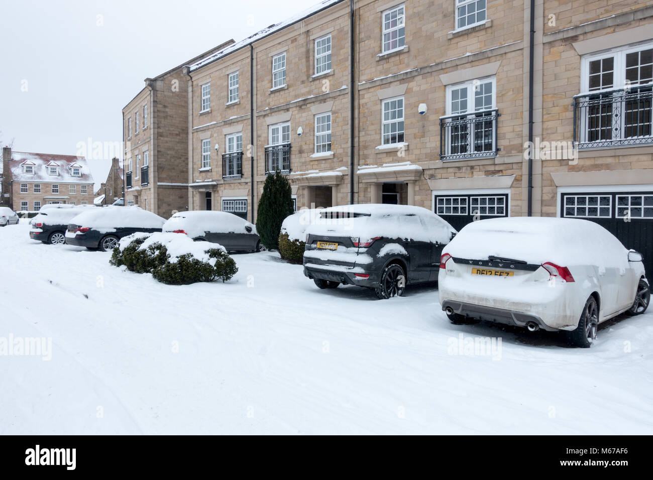 UK weather: Burley-in-Wharfedale, West Yorkshire, UK. 1st March 2018.  Snowed in, people make sensible choices leaving - Stock Image