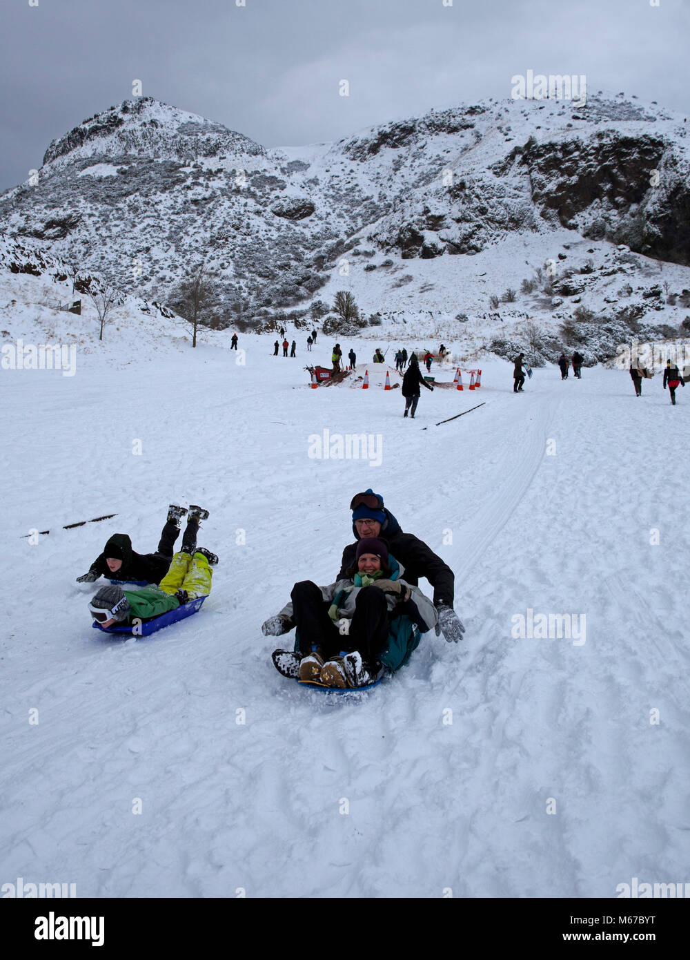 Edinburgh, Holyrood Park, Scotland, 1st March 2018, UK weather young and old enjoying sledging and skiing on the - Stock Image