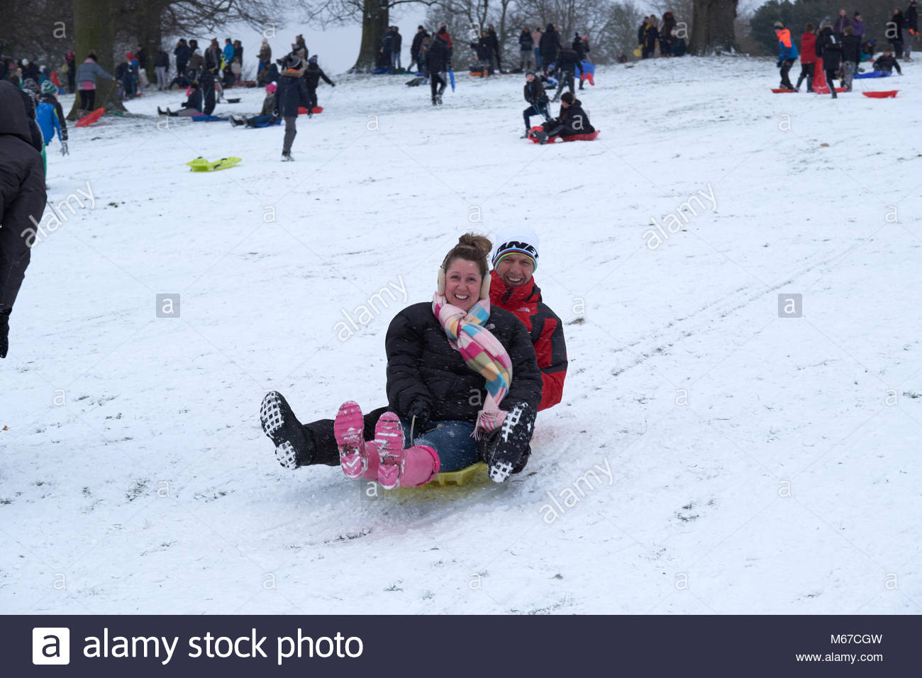 Nottingham, England, 1 March 2018 Sledging in front of Wollaton Hall in snow from 'The Beast from the East' - Stock Image