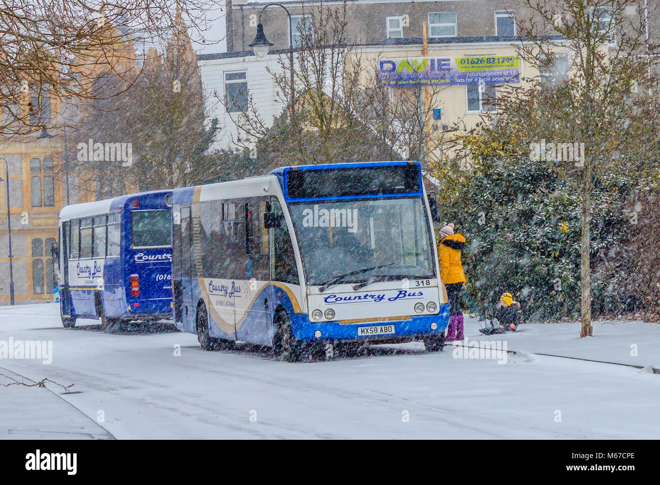 Woman and child turned away from bus as parts of Devon grind to a halt as Storm Emma arrives to be met by the cold Stock Photo