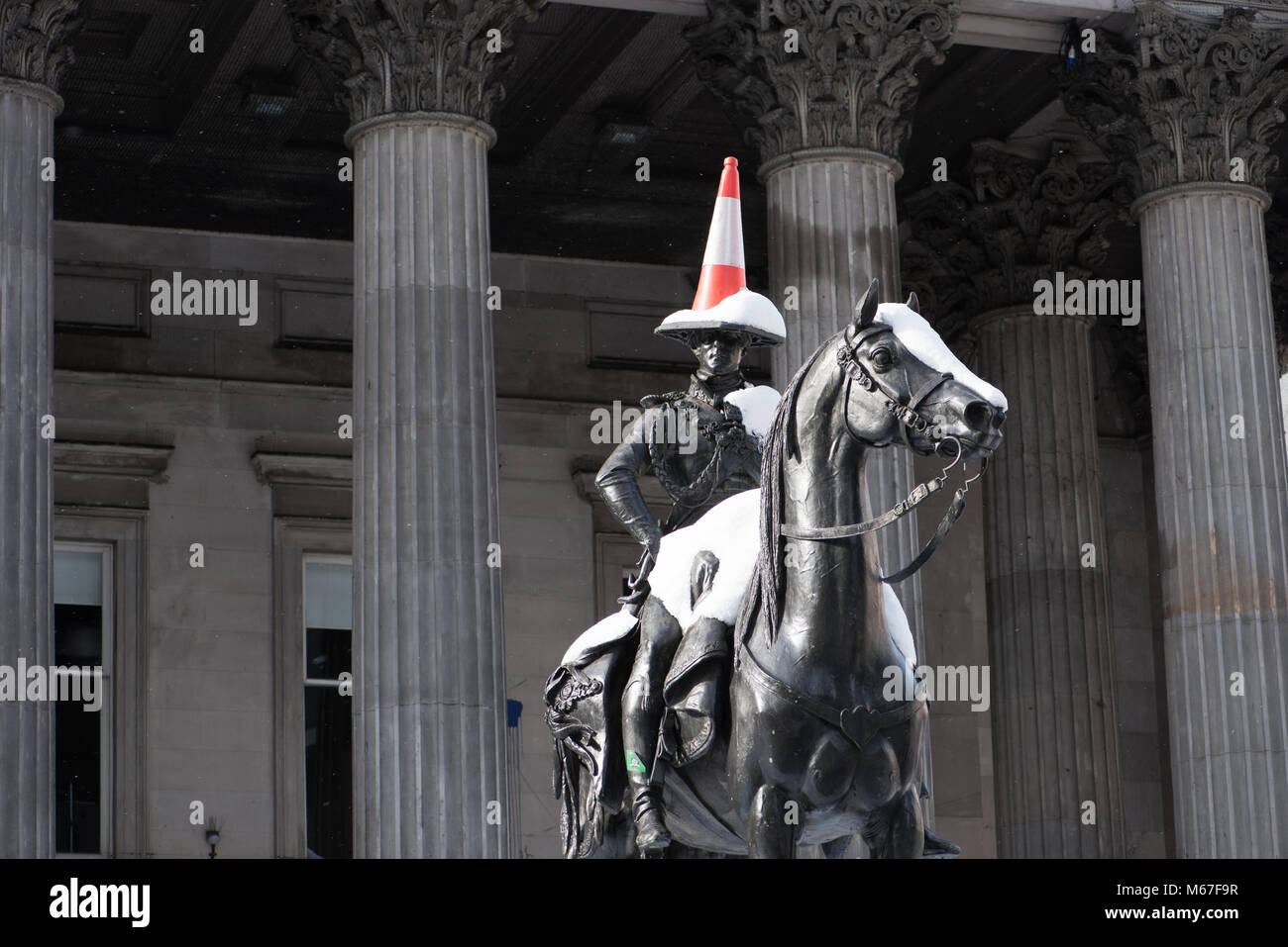 Glasgow, Scotland, UK. 1st March, 2018. Snow on Duke of Wellington Statue in Glasgow city centre as Beast from the - Stock Image