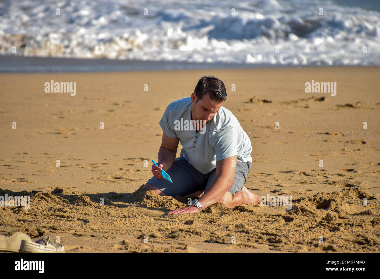 Huntington Beach California is known for it's surfing beaches but of course also for building sand castles. - Stock Image