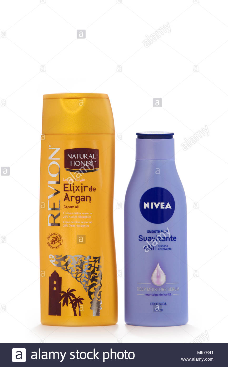 Plastic bottles of Revlon Argan oil cream, and Nivea body cream, isolated on white, with copy space - Stock Image