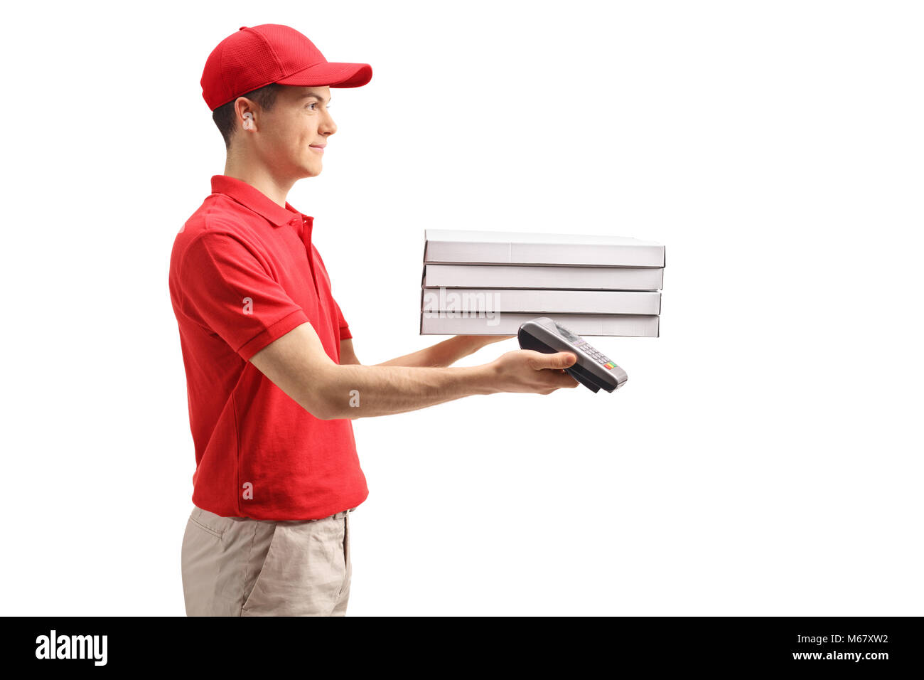 Teenage delivery boy holding pizza boxes and a payment terminal isolated on white background - Stock Image