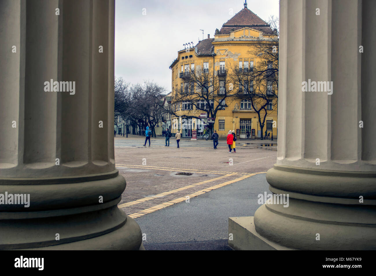 SUBOTICA, VOJVODINA, SERBIA - A view at the Square of Freedom, located in the city center, from between the pillars - Stock Image