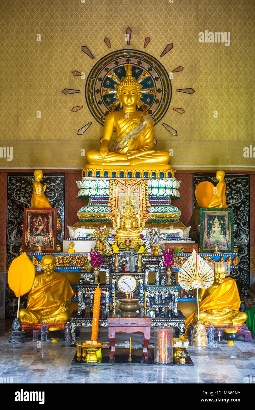 Buddhist altar in the monastery. Stock Photo