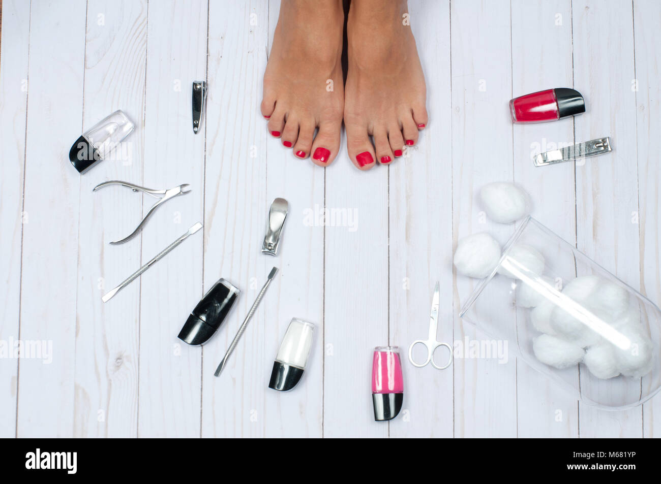 foot care treatment and nail  beautiful female feet at spa salon on  pedicure procedure -