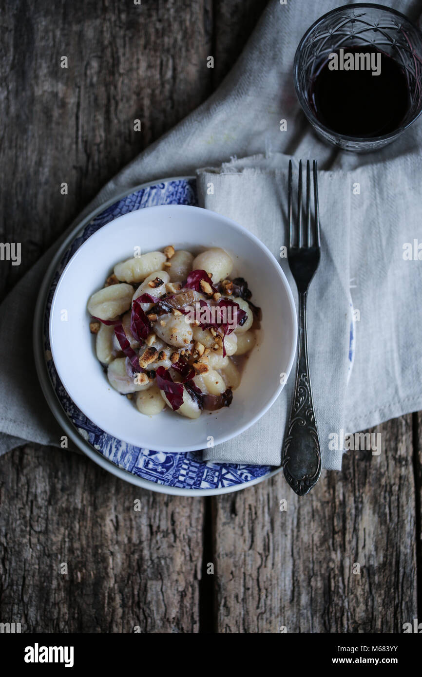 Brased red chicory and hazelnuts gnocchi - Stock Image