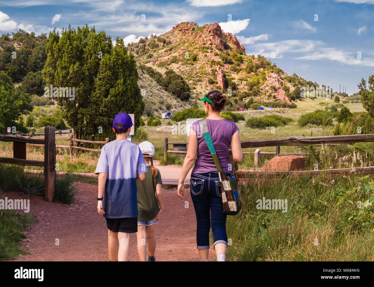 Young woman with two children walking around Garden of the Gods park in Colorado Springs, Colorado; rock formations - Stock Image