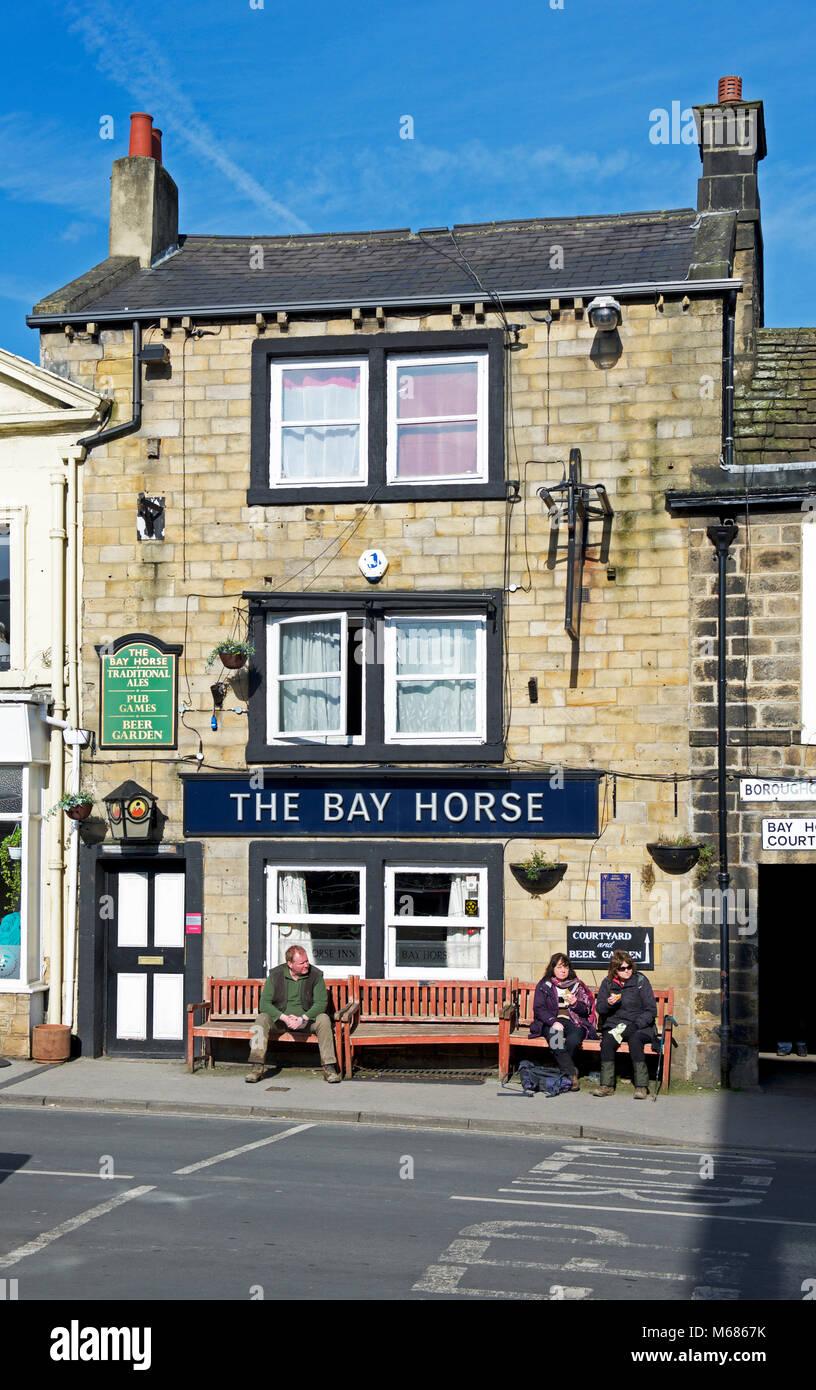 People sitting outside the Bay Horse pub in Otley, West Yorkshire, England UK - Stock Image