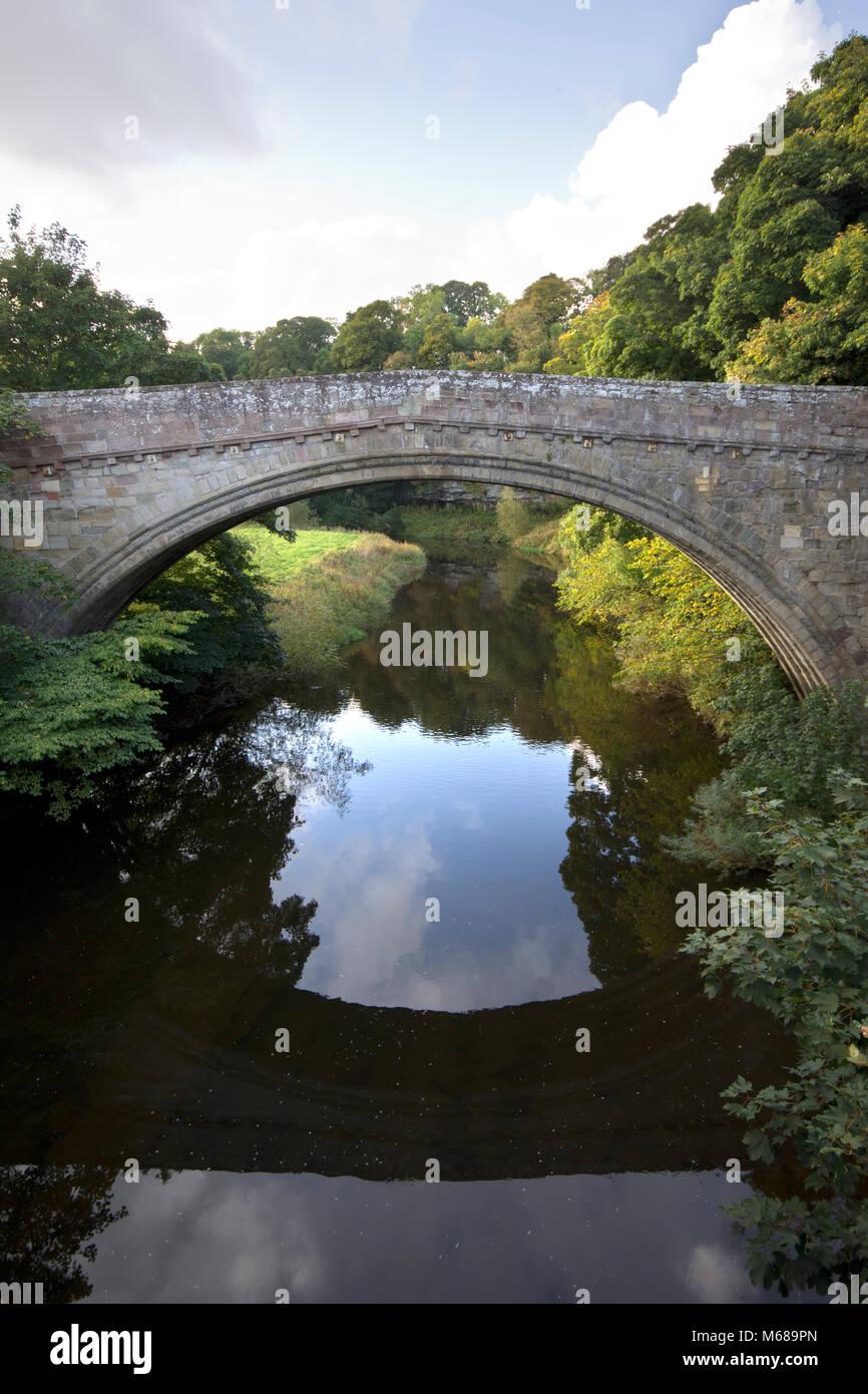 Twizel Bridge crossing the River Till Northumberland, England, UK, - Stock Image