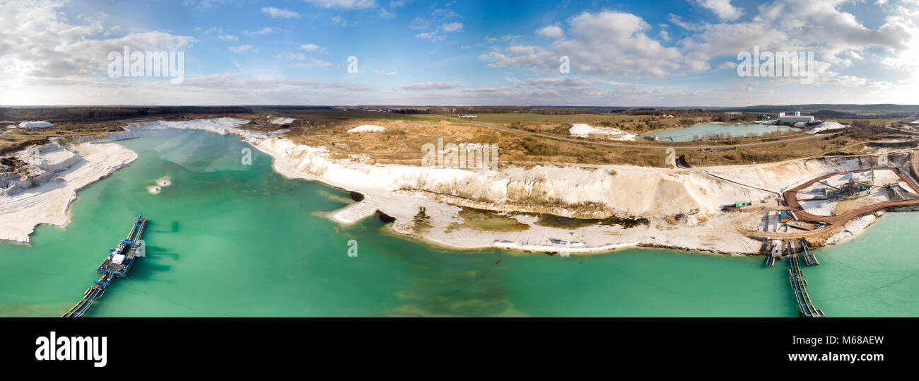 Composite panorama of aerial photographs and aerial photos of a wet mining operation for white quartz sand with - Stock Image