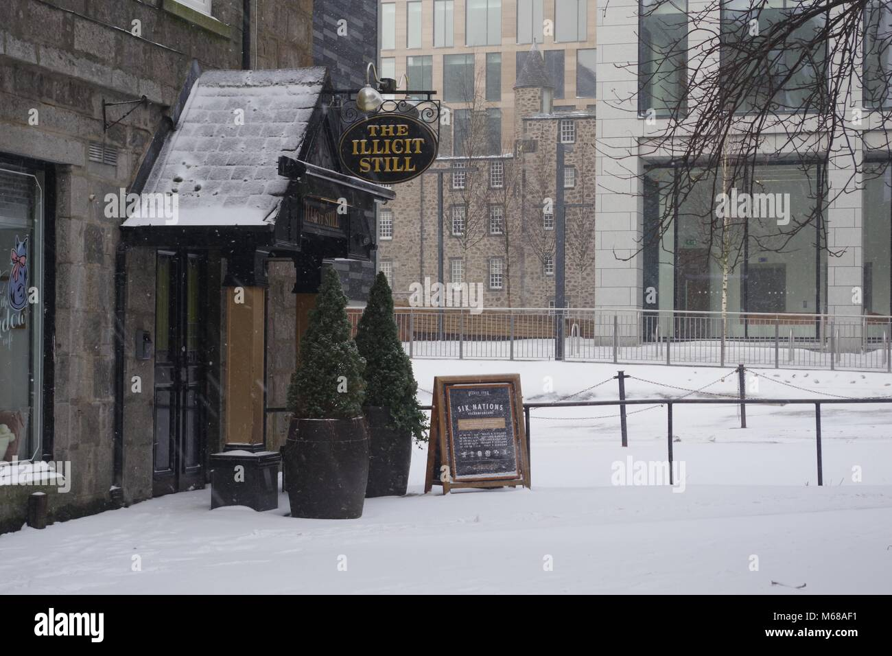 The Illicit Still Pub Porch, Scottish Pub. Beast from the East, Snow Storm Emma. Aberdeen, Scotland, UK. - Stock Image