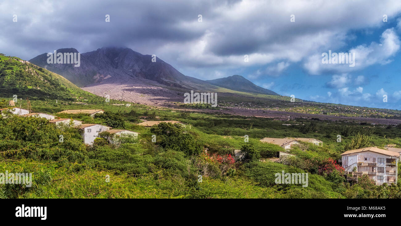 The Soufriere Hills Volcano and the deserted ex capital city of Plymouth, Montserrat after the eruption, from the - Stock Image