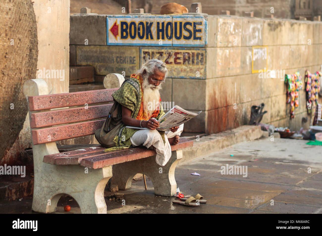 Indian man reading - Stock Image