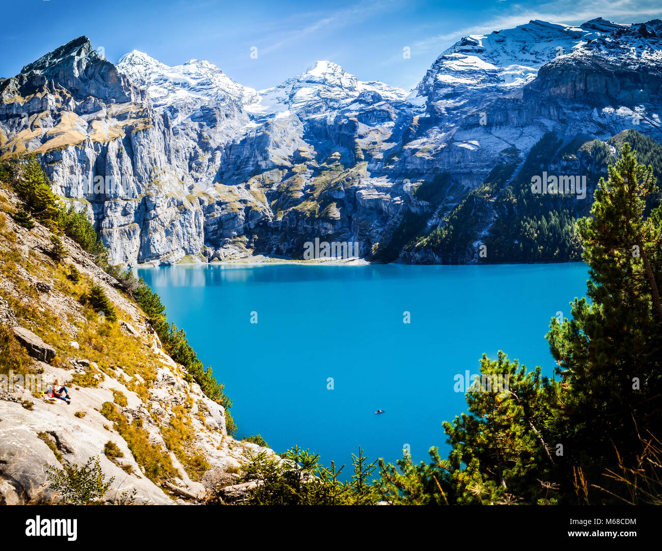 scenic view of famous mountain lake oeschinensee in switzerland kandersteg late summer in the alps with snow covered - Stock Image