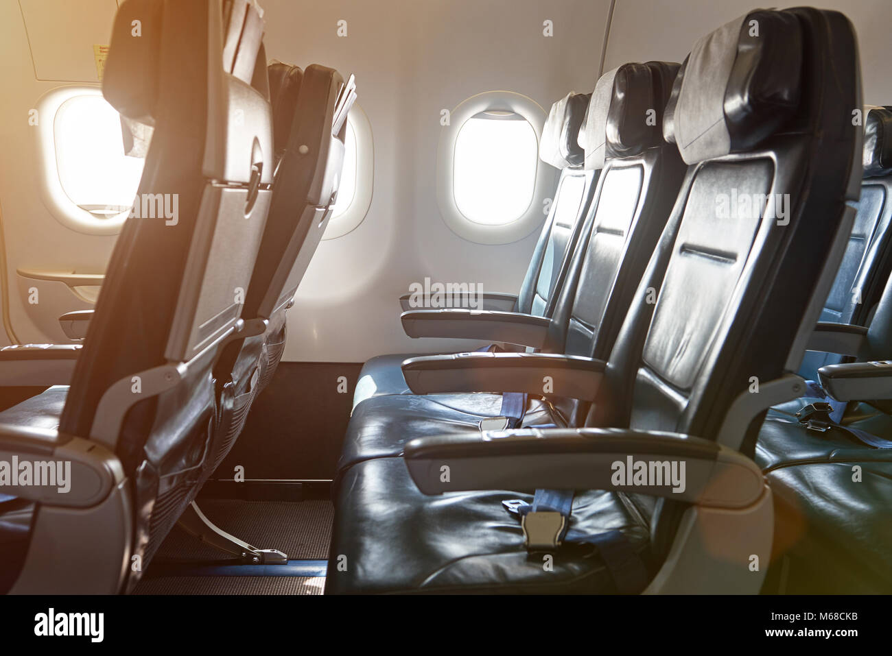Row of leather seats in airplane interior. Side view of air plane chairs & Row of leather seats in airplane interior. Side view of air plane ...