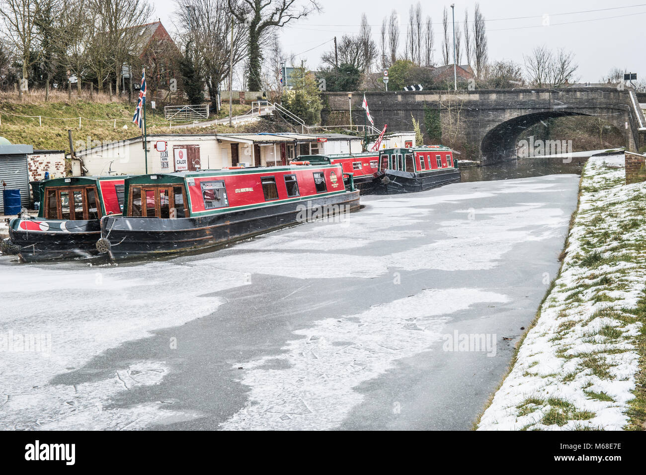 Canal boats wintering  at Preston Brook, Cheshire, UK. - Stock Image