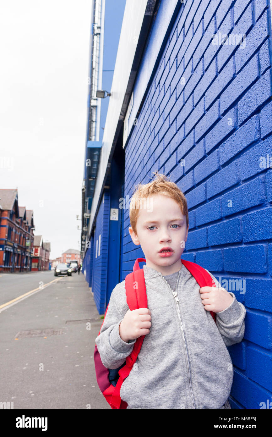A young boy standing outside Goodison Park - home to Everton Football Club. Liverpool, Merseyside. Stock Photo