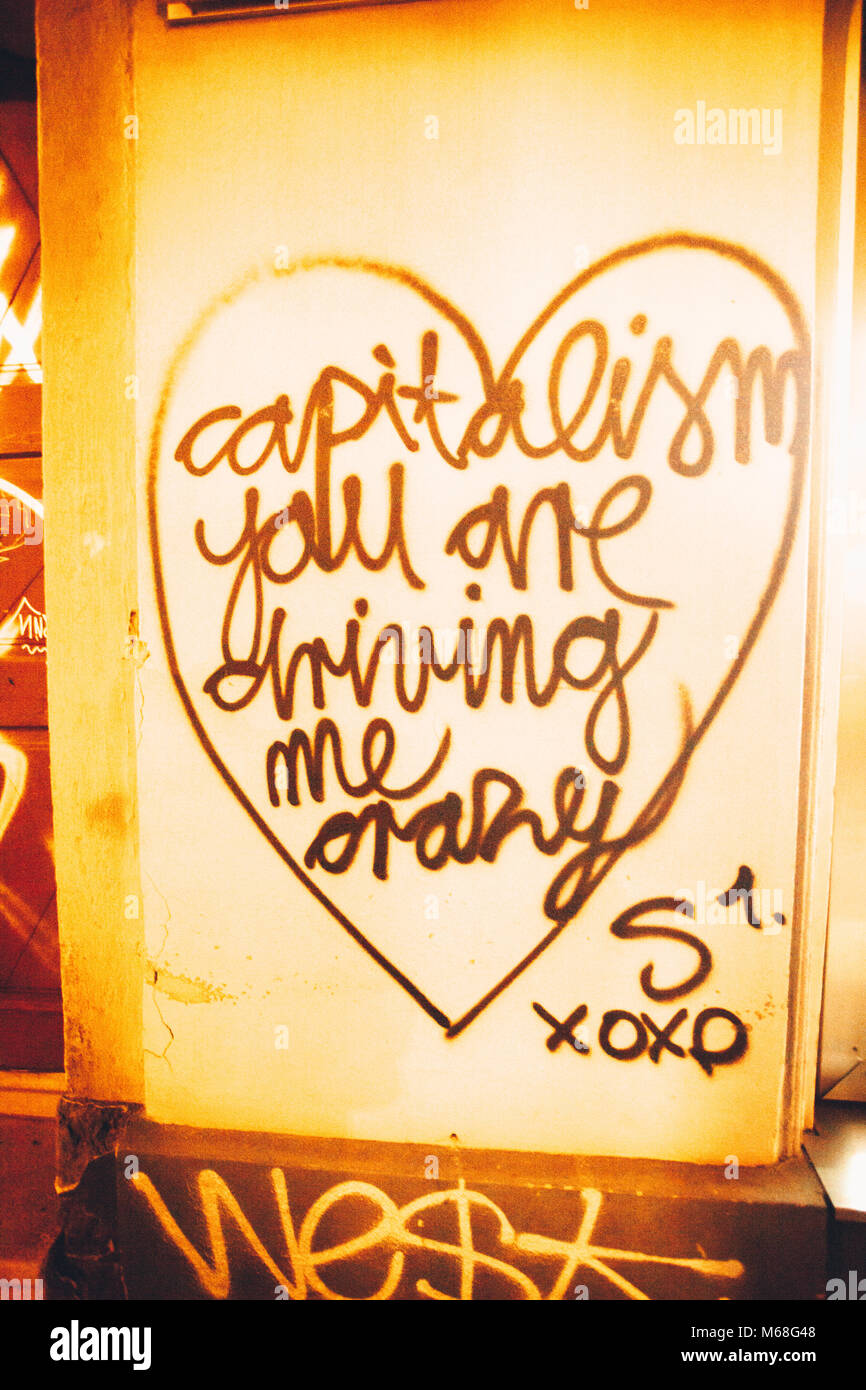 'Capitalism you are diving me crazy' a Street graffiti in Ljubliana, Slovenia, Balkans, East Europe. - Stock Image