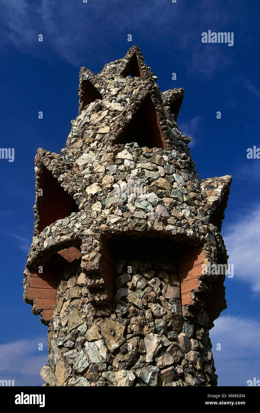 Barcelona, Catalonia, Spain. Palau Guell, 1886-1890. Designed by Antonio Gaudi. Roof terrace. Detail of a chimney. - Stock Image