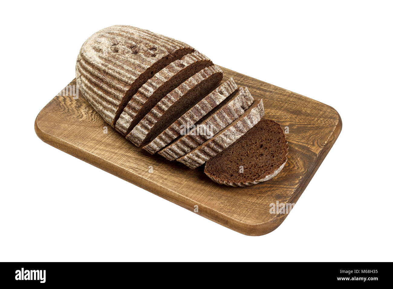 fresh sliced rye bread on wooden board isolated on white. Stock Photo