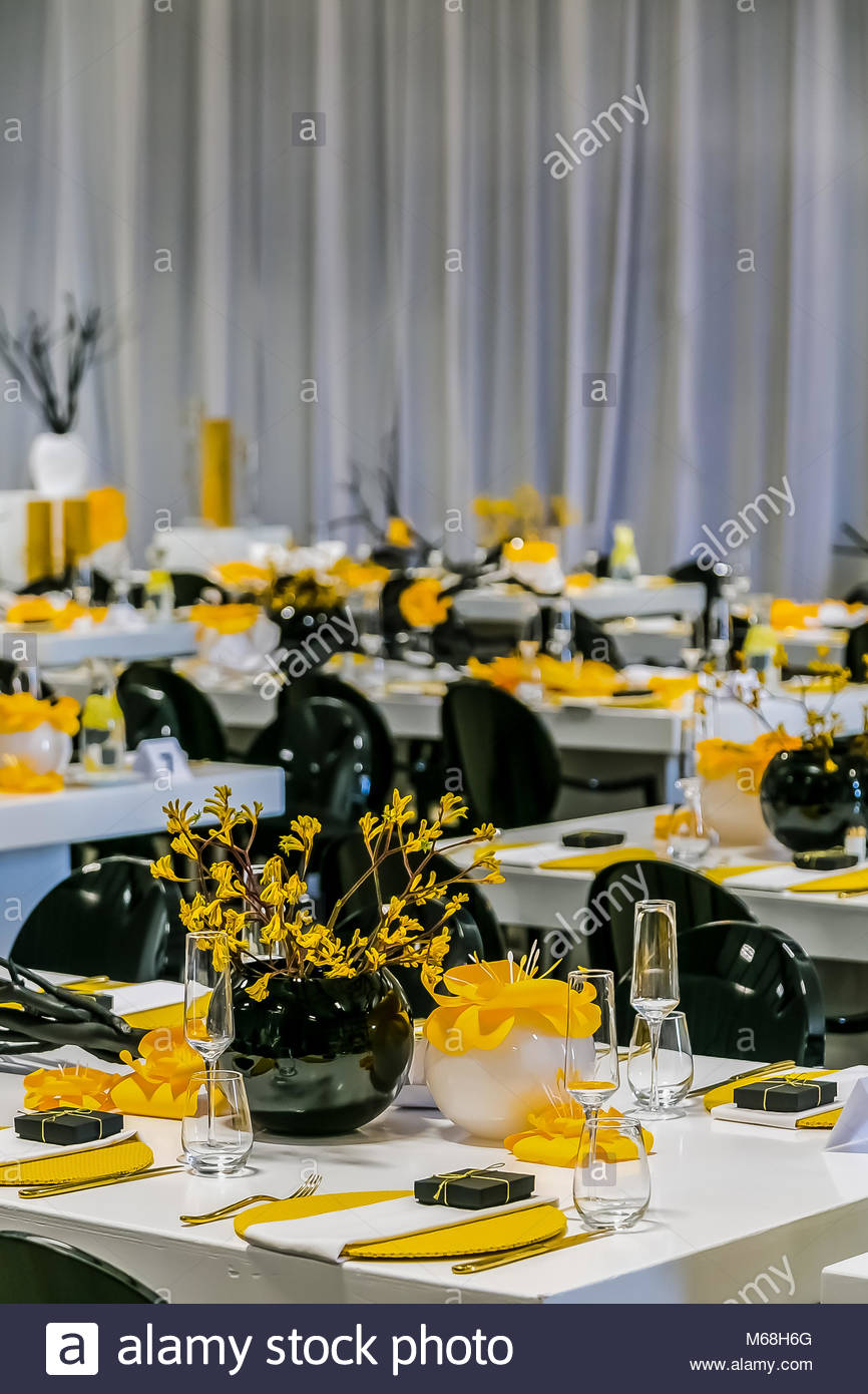 Yellow black and white table setting and decor for gala dinner or ...